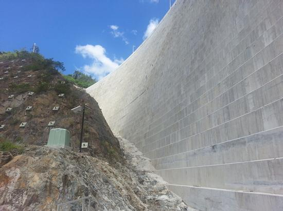 Slope near dam with monitoring equipment